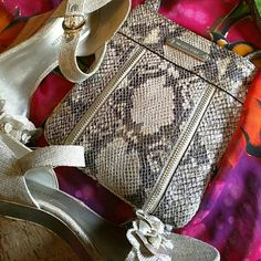 Stunning Michael Kor snakeskin cross body purse. Beautiful purse no damage. Small crossbody, can fit phone wallet and a couple other items. Michael Kors Bags Crossbody Bags