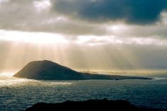 Bardsey Island -said to be the final resting place of Merlin, who sleeps in a cave guarding the treasures of Britain, waiting for a time when he is needed again.http://www.britannia.com/history/arthur/bardsey.html