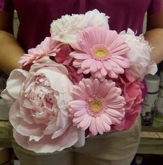 pink daisy and peony bouquet for bridal party. Needs a splash or greenery and dark blue maybe