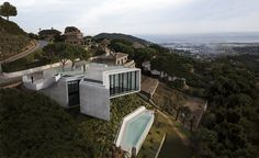 Located just outside of Barcelona and sited on steel hill overlooking a valley and the Mediterranean sea, X-House by Spanish architectural studio Cadaval & Sola-Morales has bold, fully-glazed angled frontages that look out to stunning views of the surrounding landscape. Available through ownersdirect.co.uk