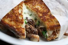 Short Rib Sandwich with Cheese, Arugula and Sweet Onions