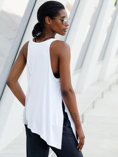 Tied Tunic | Perfect for any studio workout, this swingy tunic features soft mesh panels and a versatile open side vent for a fun knotted effect. Raw trims make for a lived-in look. Effortless, relaxed silhouette.