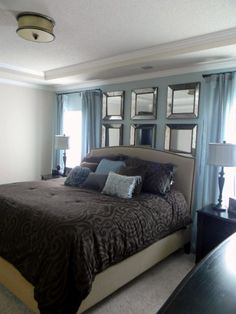the mirrors above the bed would be a good idea for a small guest room to make it look larger