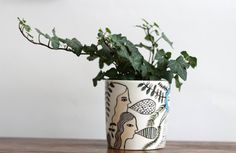 Turn a potted plant into a conversation piece with this illustrated holder by KinskaShop. #etsyfinds