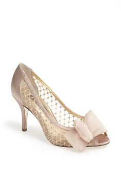 Love the crystal and mesh detail on this peep toe pump. Perfect for a bride.