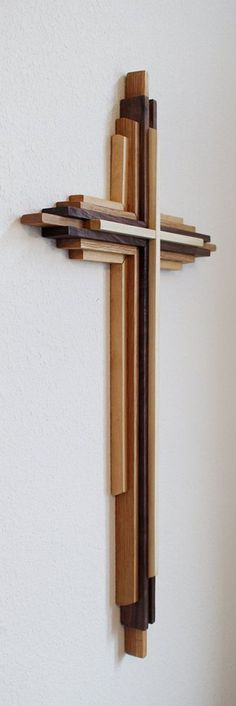 DIY Wooden Cross Plans Custom made large wooden crosses 3 to 8 feet tall. Materials Made from three separate types of solid wood. I can use any combination of domestic woods you prefer. Popular wood choices are maple, oak, & walnut, but I can use any domestic woods you choose. DenneheyDesign.com