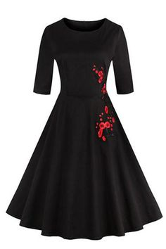 The Atomic Jane 1950's Black Vintage Inspired Rockabilly Dress is a short sleeved design with a Vintage inspired rose applique embellishment.  https://atomicjaneclothing.com/products/atomic-jane-1950s-black-vintage-inspired-rockabilly-dress