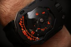 """Urwerk UR-105TA 'Clockwork Orange' Watch Hands-On - by Richard Cantley- Head over to: aBlogtoWatch.com """"Urwerk is a company known for striking designs, and the Urwerk UR-105TA 'Clockwork Orange' watch is no exception. Industrious and highly engineered, this piece demands your attention with the unique styling and memorable face. From the novelty of the turbines to the amazing satellite hours..."""""""