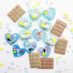 Getting ready for summer.  #ocean #cabochon #decoden #polymerclaycharm #polymerclay #seacreatures #chocolatebar #cuteart #confetti #パステル #miniatures #sweetlolita #hearts #pastelfood #pastel #スイーツデコ #fakesweets.#sweetsdeco #desert #kawaiiart #dollhouse #clayart #fakefood #summertime #spring #fairyfood #kawaiidesu #resin #resinart #glitter