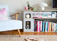 DIY cinder block bookshelf - it actually looks pretty stylish next to that chair