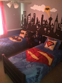 Batman vs. Superman themed bedroom. Hand painted city-scape mural as an accent…