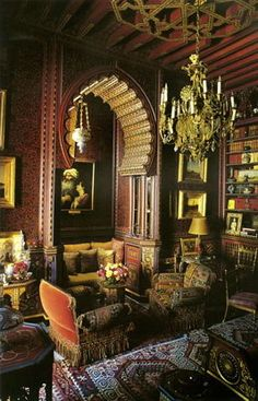 Library at Dar es Saada, one of two Marrakech homes owned by Yves Saint Laurent and Pierre Bergé. Designed by Bill Willis, guru hippie designer from the 1960's - '70's who was engaged by design and social luminaries in Marrakech. He created rooms so romantically over the top that they recall tales told by Scheherazade. Constants in his design vocabulary included flamboyant tiles, billowing domes, majestic fireplaces, and the softly polished waterproof plaster known as tadelakt.