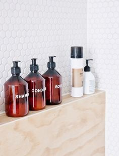 Uniform bottles in shower, matching bottles in shower, streamlined shower