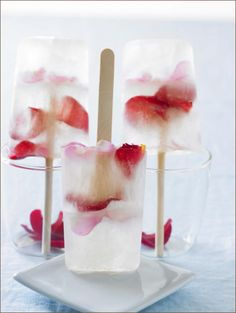Ferreira's Prosecco Pops... laced with rose water and frozen with layers of multihued rose petals, are perfect for swankier affairs.