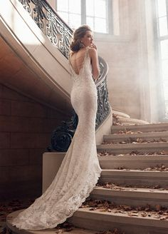 This beautiful Ivory/Silver alencon lace trumpet bridal gown by Lazaro is now at Gigi's of Mequon!