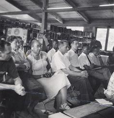 Highlander Folk School Library (1957). Monteagle, TN. Left to right (Rosa Parks, unknown, Myles Horton, Aubrey Williams, Martin Luther King, Jr.)