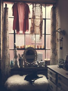 Beautiful vanity area in front of factory-style window. Plenty of natural light. Very bohemian, industrial, artsy.