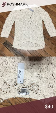 Women's sweater Women's high low sweater. New with tags. Fits like a Large. Sweaters Crew & Scoop Necks