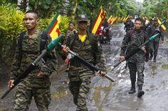 Moro Rebellion Philippines | Moro Islamic Liberation Front (MILF) rebels patrol inside their camp ...