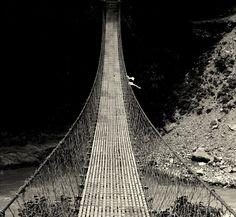 Into the Darkness by Hasan Mahmud Tipu... Hanging bridge in Nepal