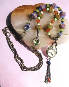 "30"" ""Time For a Change"" necklace, chock full of colorful, hand-made lampwork beads, layered chains and Swarovski rivoli crystals. Comes with FREE matching earrings!   $40.00 + shipping  SOLD!"