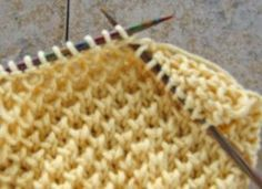 Knitting Stitches - The Bee Stitch and Knitting 1 Below - this is a nicely textured stitch with a waffle texture. Also -- it's really just a variant of Garter Stitch, so it's very easy to make.