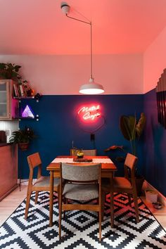 This is how two people with distinct styles can cultivate a well-designed home. It's filled with original neon lights, antiques and lots of color.