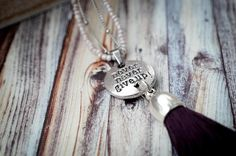 An encouraging necklace to remind you to never give up! One strand of light purple beads and a stainless steel chain hold the charm and a black tassel together. Wear this when you need a reminder to keep going. Purple Glass, Stainless Steel Chain, Bead Caps, Light Purple, Never Give Up, Silver Color, Antique Silver, Tassel, Necklaces