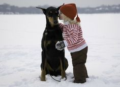 #Doberman and girl in the snow