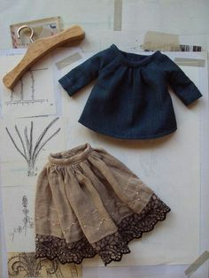 This outfit set consists of a beautiful indigo blue blouse, worn over a lovely delicate cotton skirt with vintage lace border. Girl Doll Clothes, Barbie Clothes, Girl Dolls, Diy Clothes, American Girl Outfits, Doll Dress Patterns, Clothing Patterns, Moda Barbie, Fashion Dolls