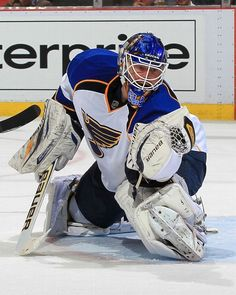 Goalie Brian Elliott makes a glove save during a game against the Red Wings.  Blues won the game 1-0.       4-07-13