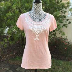 Warm Pink T-shirt with Lace This is a warm pink color t shirt with caps. There is a pretty lace design attached around the collar. 100% cotton. ESPRIT Tops Tees - Short Sleeve