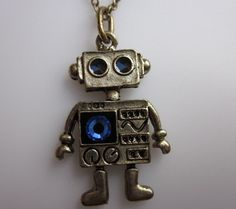 MINI ROBOT NECKLACE. A Vintage Style Robot Charm Necklace in Antique Gold Finish with Sapphire Blue Swarovski Gem.