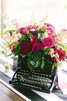 typewriter with flowers - photo by AL Gawlik Photography http://ruffledblog.com/vibrant-eclectic-ranch-style-wedding