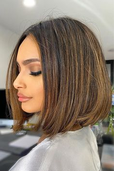 Stay modern and trendy with these brown highlights on bob hair created by hairstyle educator Natalie Anne (@natalieannehair). A blunt perimeter makes a bob look fresh and healthy. Hit the link to find some hair inspo with our list of stylish blunt bob haircuts. #bluntbobhaircuts #bluntbobhairstyles