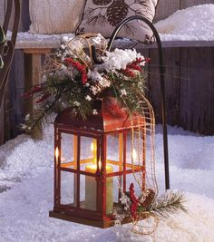 A lantern makes a pretty outdoor holiday decoration! #fabulouslyfestive