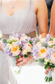 These soft, romantic light purple tones are great for a spring or summer wedding. Bridesmaid bouquets by: City Blossoms NYC Photo courtesy of: Fat Orange Cat Studio