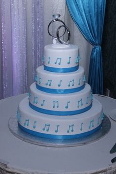 Looking for a unique but simple and economic cake to fit your Music Theme Wedding? Music Note Cake with Turquoise Ribbon - Turquoise and White