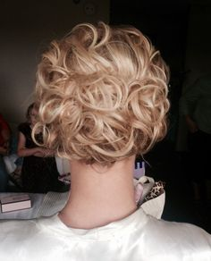 Loose curly swept back curl into a pretty and romantic curly bun #wedding #updo #stylebykendyl