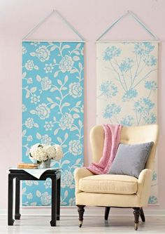 Hang it anywhere  Instead of running wallpaper across an entire wall, hang just two strips. Attach paper to plastic or wooden dowels and tie on colored ribbon.
