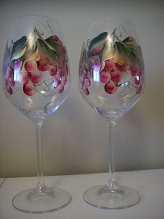 These glasses are painted with a grape design in burgundy and gold