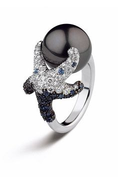 Oh, beautiful!! Mikimoto black pearl Starfish ring... Only $12,000 doll hairs!!