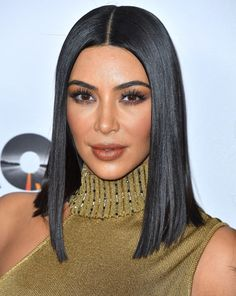 Click ahead for Kim Kardashian's Top Products for Shiny Hair