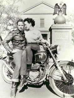 Marlon Brando 50s motorcycle with woman jeans sportswear vintage fashion style Hollywood movie star snapshot