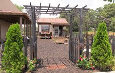 As you pass under the front wooden arbor into the garden, you come to our new center fountain, and we have just begun to fill in this area with iron gazebos and antique garden accents, with a recycled brick walkway in the planning.