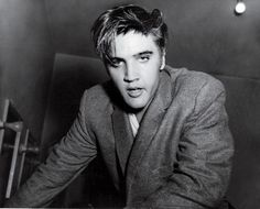 An exhausted and sweatty Elvis Presley photographed backstage at the Oakland Auditorium in Oakland, CA on Sunday, June 3, 1956. Elvis played two shows there that day at 3:00 pm and 8:00 pm. See more here: http://www.scottymoore.net/oakland.html