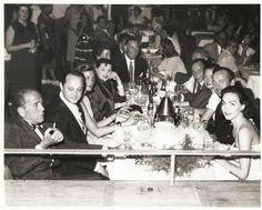 A rare photo of the original Rat Pack, which was centered around Humphrey Bogart and got its name from Lauren Bacall.