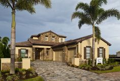 The new Solivita Model by Lee Wetherington has one of the most amazing floor plans, we highly recommend it! Best Flooring, Spanish Colonial, Home Builders, Custom Homes, House Plans, Home And Family, New Homes, Floor Plans, Mansions