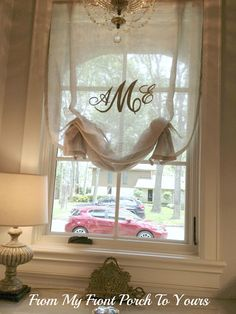 Monogramed sheer Window Treatment. Cool go on top of regular blackout curtains!