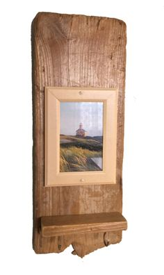 "Boothbay Frame / Key Hook  Driftwood backing with formed molding to frame any photo. A charming Maine coast seascape or lighthouse photo included, or add your own memory.  Includes a small shelf for additional decor and key hooks.   Product Dimensions**: 7"" W x 19.25"" H x 2.5"" D"